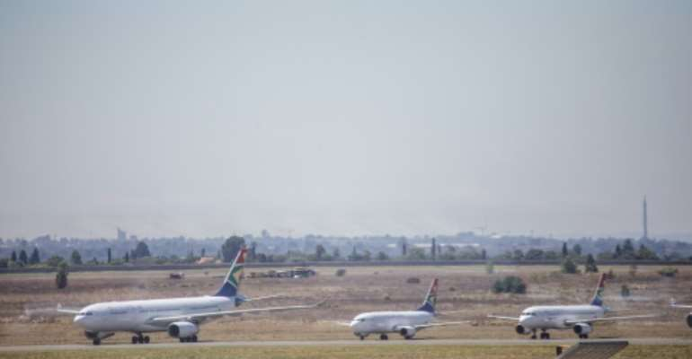 South African Airways says it may axe even more flights in order to ensure continued operations.  By Michele Spatari (AFP/File)