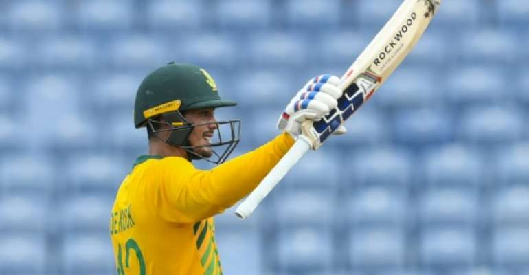 South African batsman Quinton de Kock celebrates his half century during the final T20 international against the West Indies on Saturday.  By Randy Brooks (AFP)