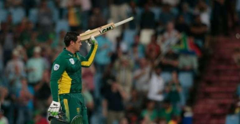South African batsman Quinton De Kock raises his bat as he celebrates scoring a century during his ODI cricket match against Australia on September 30, 2016 in Centurio, South Africa.  By Gianluigi Guercia (AFP)