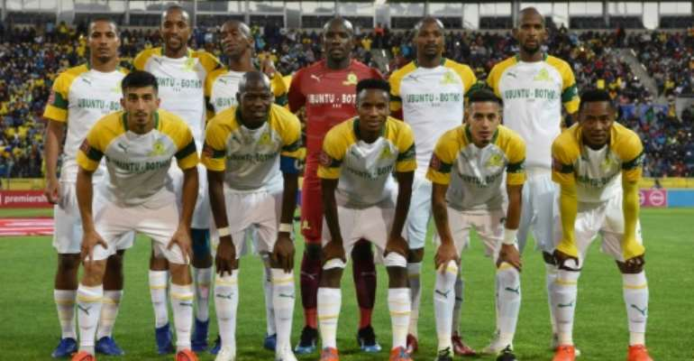South African club Mamelodi Sundowns trounced Egyptian visitors Al Ahly 5-0 Saturday in the first leg of a CAF Champions League quarter-final.  By RODGER BOSCH (AFP)