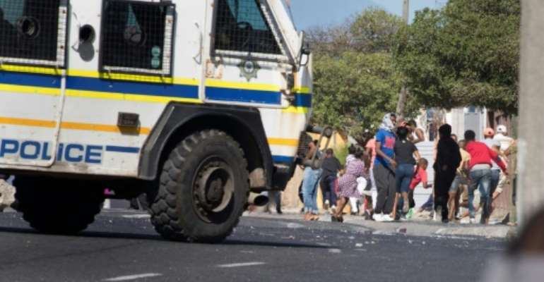 South African police clashed with Cape Town township residents protesting over access to food aid during a coronavirus lockdown.  By RODGER BOSCH (AFP)