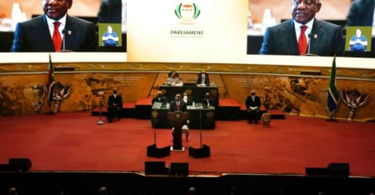 South African President Cyril Ramaphosa addresses the nation on the COVID-19 epidemic in Pretoria on March 15, 2020; Ramaphosa said the country would close its borders to all foreign nationals from countries highly impacted by the virus.  By Phill Magakoe (AFP)