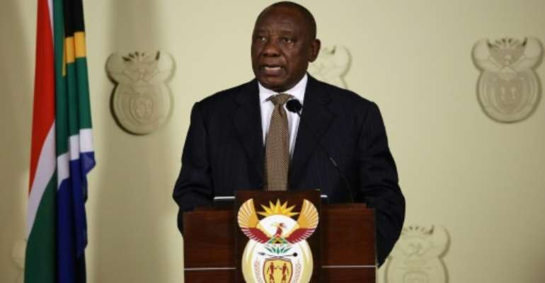 South African President Cyril Ramaphosa announced a sweeping reshuffle that included re-appointing Nhlanhla Nene, who was sacked by Jacob Zuma, as finance minister.  By Phill Magakoe (AFP/File)