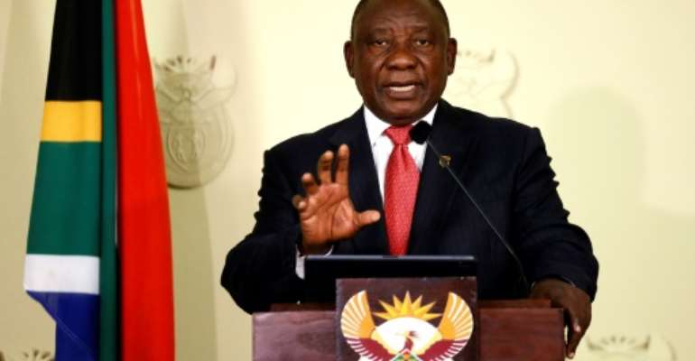 South African President Cyril Ramaphosa announces the composition of the new cabinet, half of which is now female.  By Phill Magakoe (AFP/File)