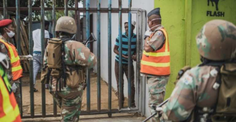 South African soldiers patrolled the streets alongside police during the country's lockdown.  By MARCO LONGARI (AFP/File)