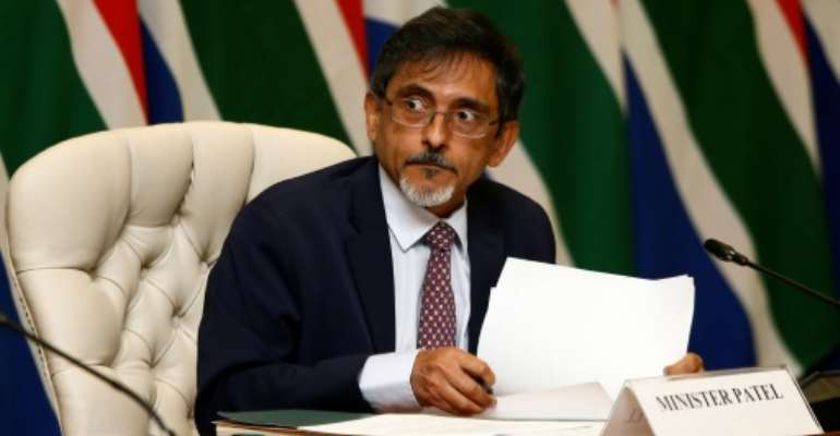 South African Trade Minister Ebrahim Patel, pictured in March 2020, is among four ministers and several MPs who have so far contracted coronavirus in South Africa.  By Phill Magakoe (POOL/AFP/File)