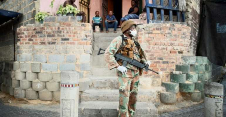 South African troops are enforcing a 21-day lockdown against the virus.  By Luca Sola (AFP)
