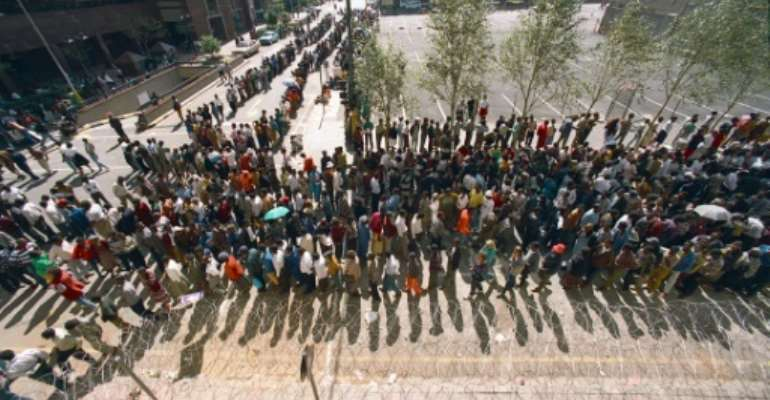 South Africans queue to cast their votes in Johannesburg on April 27, 1994, in the country's first all-race elections.  By MIKE PERSSON (AFP/File)