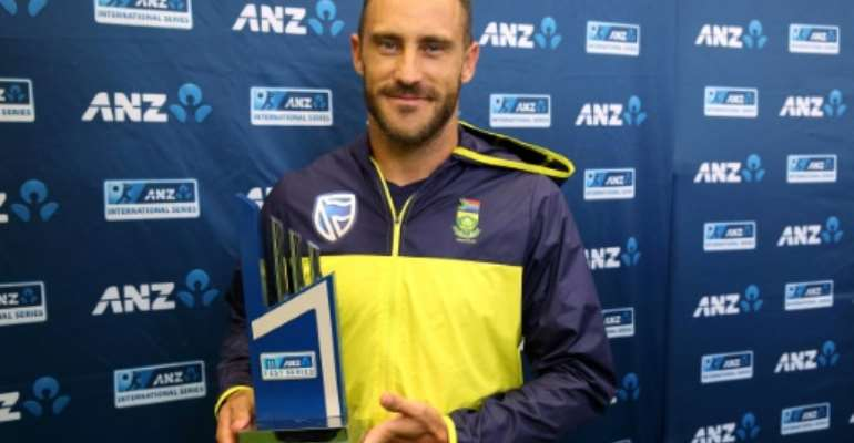 South Africa's captain Faf du Plessis holds the trophy on the day five of their third Test match against New Zealand, after the last day's play was called off due to rain, at Seddon Park in Hamilton, on March 29, 2017.  By Michael Bradley (AFP)