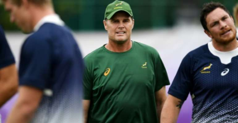 South Africa's head coach Rassie Erasmus (C) supervises training session at the Arcs Urayasu Park in Urayasu, Chiba Prefecture on September 16.  By CHARLY TRIBALLEAU (AFP)