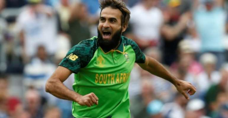 South Africa's Imran Tahir celebrates taking the wicket of England captain Eoin Morgan.  By Ian KINGTON (AFP)