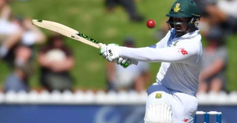 South Africa's keeper Quinton de Kock races to his eighth Test 50 in 55 balls in the second Test against New Zealand in Wellington.  By Marty MELVILLE (AFP)