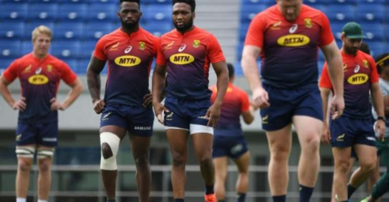 South Africa's Pieter-Steph du Toit (L), captain Siya Kolisi (2nd L), Lukhanyo Am (C), Steven Kitshoff (2nd R) and Willie Le Roux (R) take part in a training session a day before their friendly rugby match against Japan, at the Kumagaya Rugby Stadium in Kumagaya on September 5, 2019..  By CHARLY TRIBALLEAU (AFP)