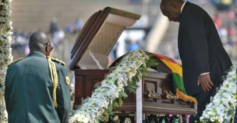 South Africa's President Cyril Ramaphosa said a final farewell at the casket of late Zimbabwean president Robert Mugabe.  By TONY KARUMBA (AFP)