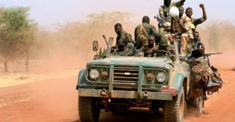 Sudanese soldiers ride in a military vehicle in the oil region of Heglig in April 2012.  By Ashraf Shazly (AFP/File)
