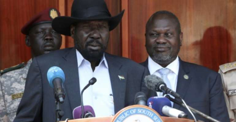 South Sudan President Salva Kiir, centre, and former vice-president and political rival Riek Machar, pictured in February 2020. Their unity government remains fragile.  By PETER LOUIS (AFP)