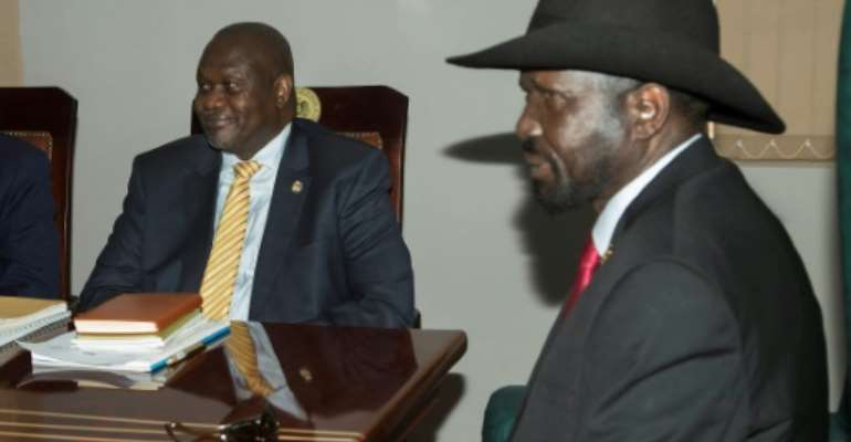 South Sudan rebel leader Riek Machar, left, meets with President Salva Kiir in Juba to try and salvage a peace deal.  By AKUOT CHOL (AFP)