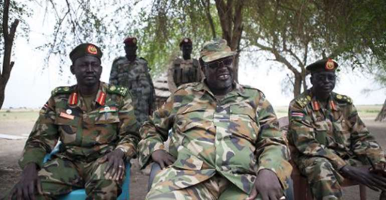 South Sudanese rebel leader and former vice president Riek Machar (centre) attends an interview in Nasir, on April 14, 2014.  By Zacharias Abubeker (AFP)