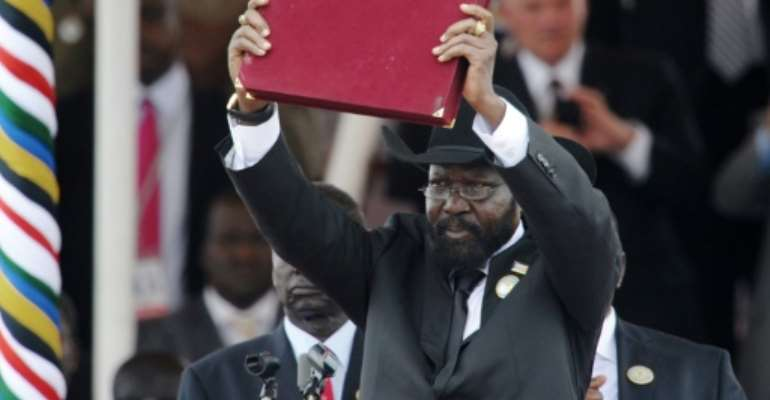 South Sudanese President Salva Kiir brandishes  the country's new constitution on July 9, 2011.  By Roberto SCHMIDT (AFP/File)