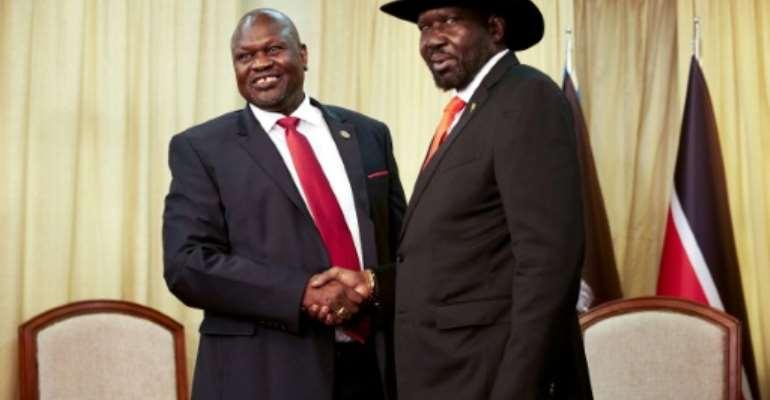 South Sudan's former rebel leader Riek Machar (left) meets with South Sudan's President Salva Kiir in October 2019.  By Alex McBride (AFP/File)