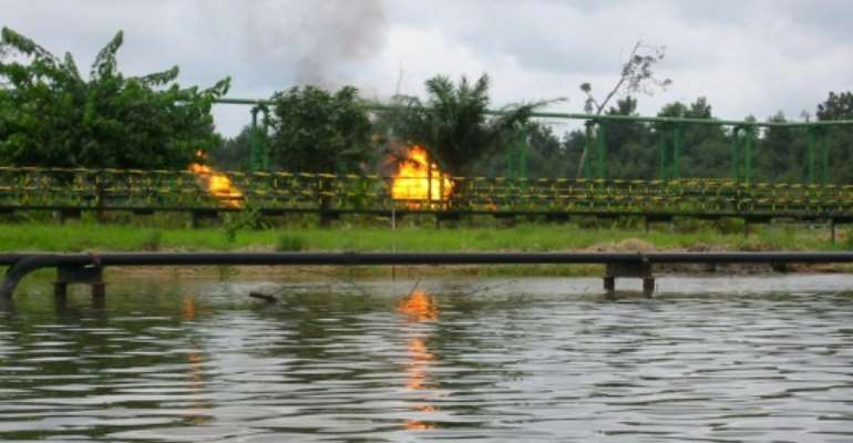 A spate of attacks claimed by the Niger Delta Avengers has hit oil production in Nigeria, exacerbating a financial crisis caused by low global crude prices since mid-2014.  By Dave Clark (AFP/File)