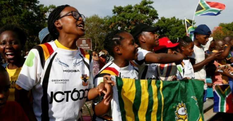 Soweto Rugby School Academy's girl players await the return of their Springbok heroes after winning the World Cup.  By Phill Magakoe (AFP)