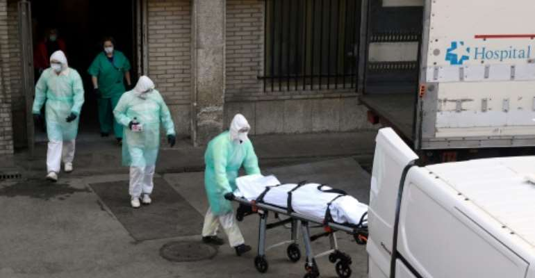 Spain joined Italy today in seeing its death toll from the coronavirus epidemic surpass that of China.  By OSCAR DEL POZO (AFP)