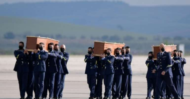 Spanish air force officers carried the coffins containing the bodies of  the three Europeans killed.  By JAVIER SORIANO (AFP)