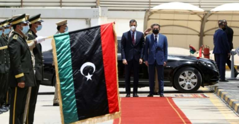 Spanish Prime Minister Pedro Sanchez (L) is welcomed by his Libyan counterpart Abdulhamid Dbeibah in Tripoli on June 3, 2021.  By Mahmud Turkia (AFP)