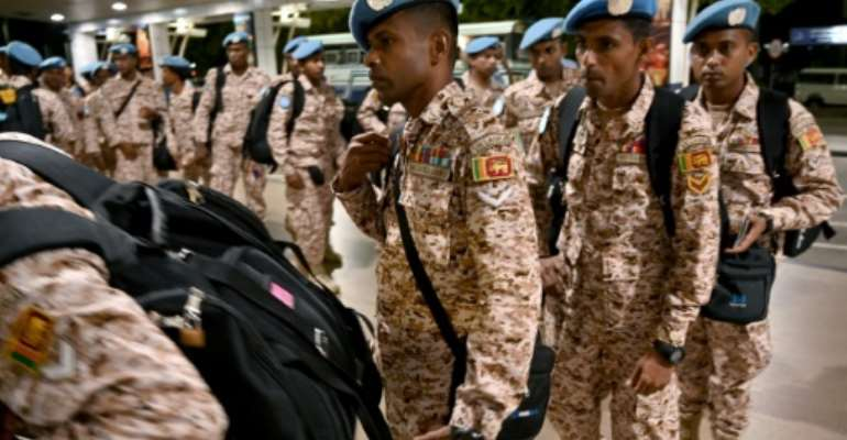 Sri Lanka Army troops en route to Mali to join the UN peacekeeping mission there in November 2019.  By ISHARA S. KODIKARA (AFP)