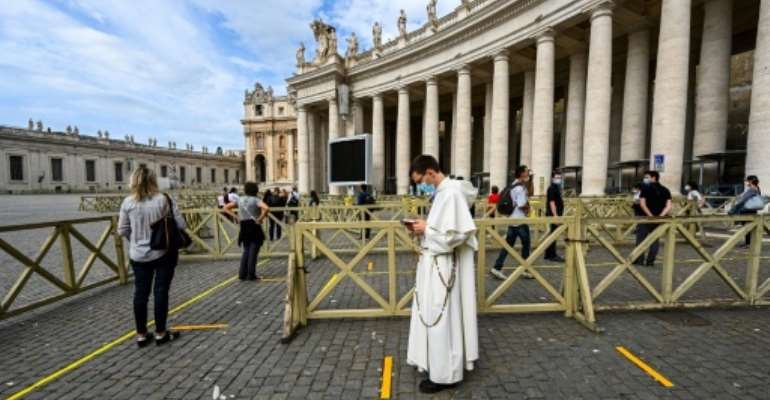 St. Peter's Basilica in the Vatican City was one of the major religous sites to reopen Monday.  By Vincenzo PINTO (AFP)