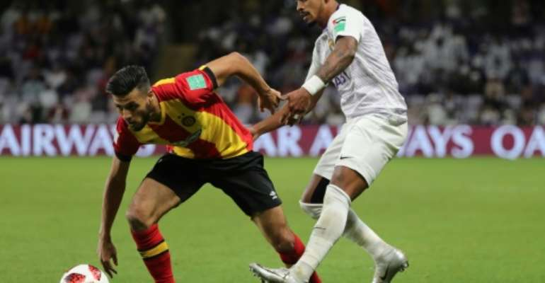 Star striker Anice Badri (L) from trophy-holders Esperance has struggled to score in the competition this season, netting just twice.  By Karim Sahib (AFP/File)