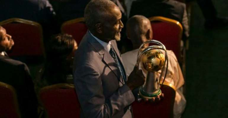 Stephen Tataw carries the trophy of the African Championship of Nations (CHAN) to the stage during the draw ceremony in Yaounde in February.  By STRINGER (AFP/File)