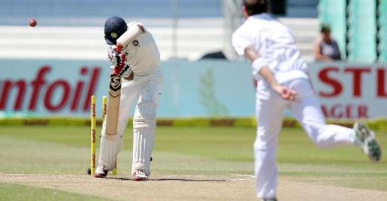 Cheteshwar Pujara (left) is clean bowled by Dale Steyn in Durban on December 30, 2013.  By Anesh Debiky (AFP)