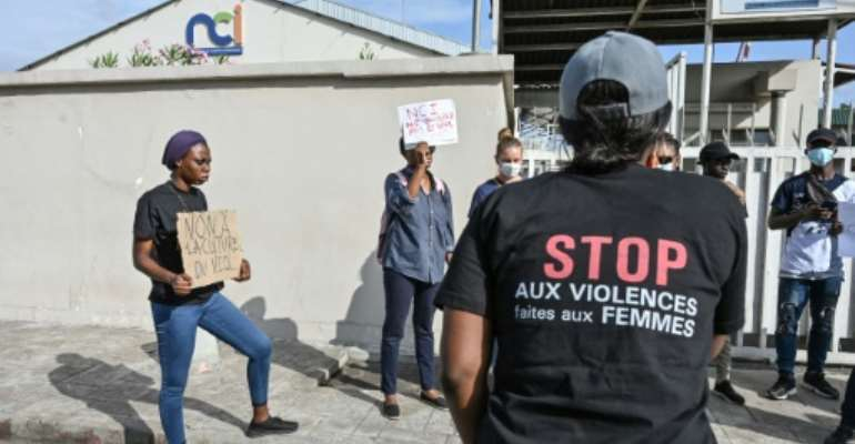 'Stop violence against women': A rights group says Ivorian women suffer an average of five sexual assaults and two rapes each day.  By Sia KAMBOU (AFP)