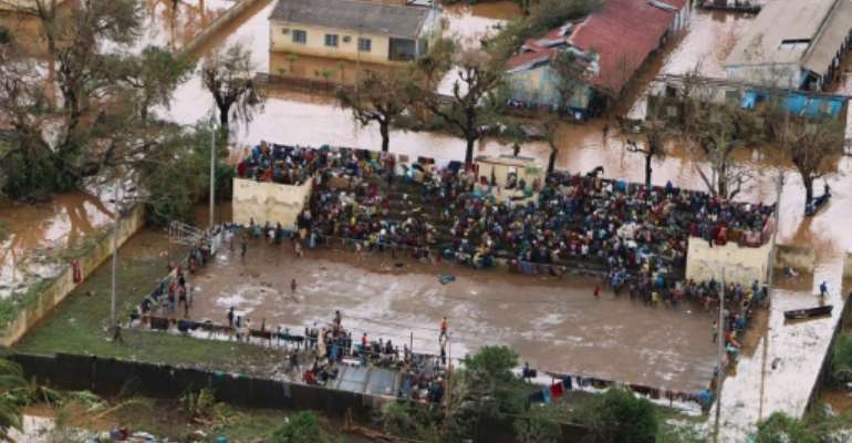 Stranded: Survivors of Cyclone Idai gather at the basketball stadium in Buzi, central Mozambique -- a relative haven from the flood water.  By ADRIEN BARBIER (AFP)