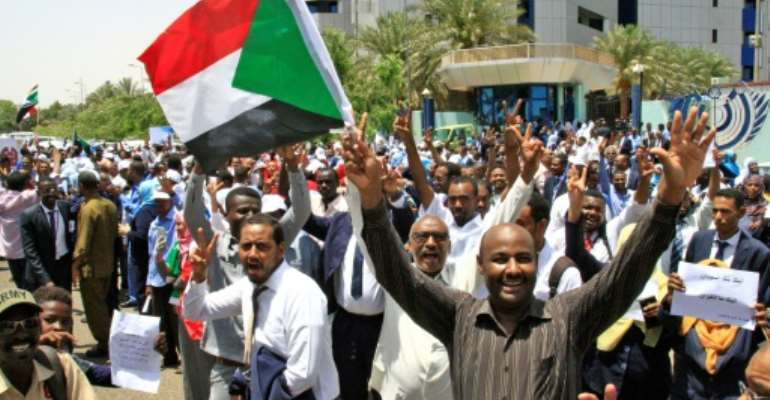 Striking workers have demonstrated outside Sudan's Central Bank to demand ruling generals hand power to civilians.  By Ebrahim Hamid (AFP)