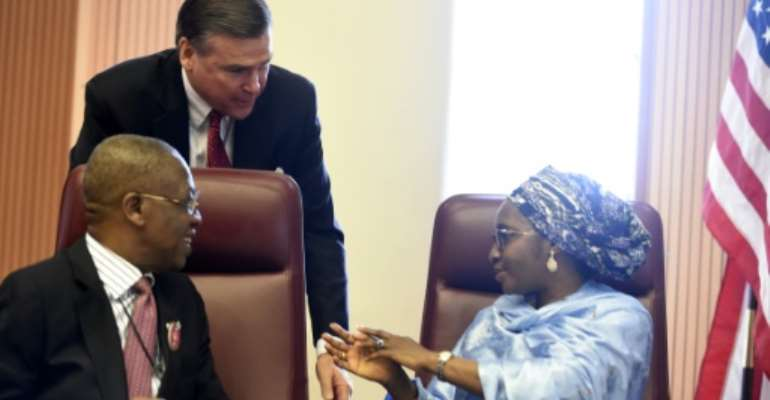 Stuart Symington, who has been appointed as the US special envoy on South Sudan, stands behind two Nigerian ministers in 2017 when he was ambassador to Abuja.  By PIUS UTOMI EKPEI (AFP/File)