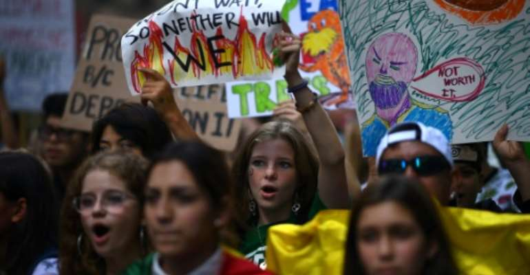 Students participate in the Global Climate Strike march on September 20, 2019 in New York.  By Johannes EISELE (AFP)