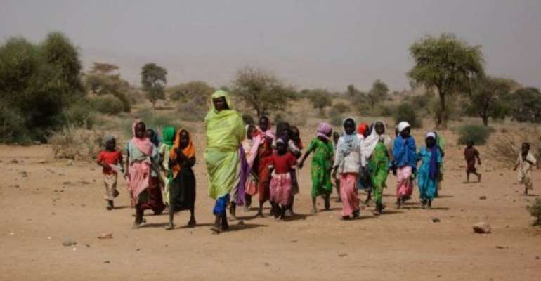 Sudanese women and children are shown March 23, 2011 in Fanga Suk, northern Darfur.  By Olivier Chassot (UNAMID/AFP/File)