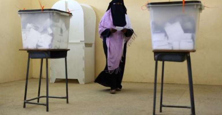 A Sudanese woman prepares to cast her vote at a polling station in Khartoum on April 15, 2015.  By Patrick Baz (AFP)