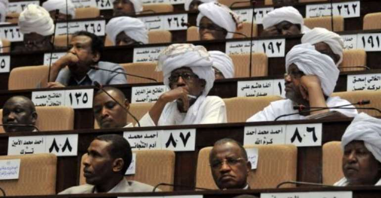 Sudanese MPs attend a parliament session in the capital Khartoum.  By Ebrahim Hamid (AFP)