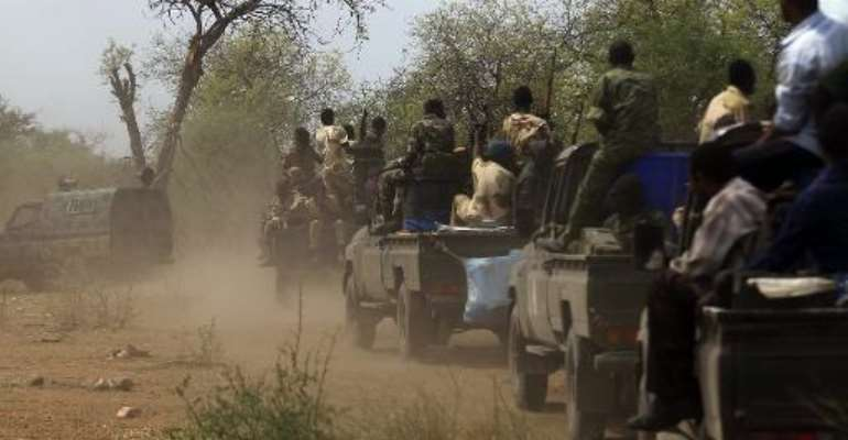 This photo taken on May 20, 2014 shows Sudanese soldiers patrol the Daldako area, about 12 miles northeast of the capital, where the rebels shelled in a counter attack Saturday.  By  (AFP/File)