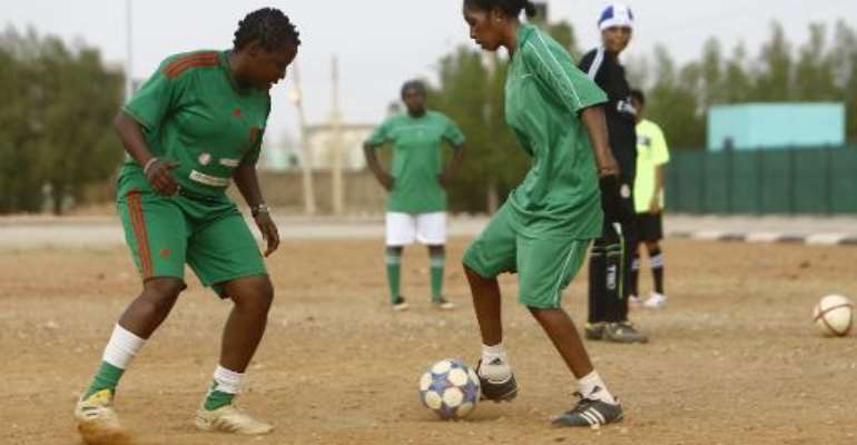 Sara Edward (L), the coach of Sudanese female football team