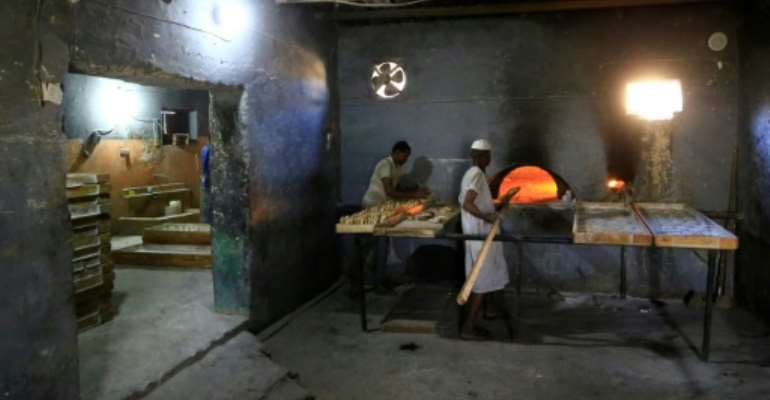 Sudanese bakers prepare loaves in Atbara, the cradle of protests against the price of bread this time last year which eventually brought the downfall of President Omar al-Bashir in April.  By ASHRAF SHAZLY (AFP)
