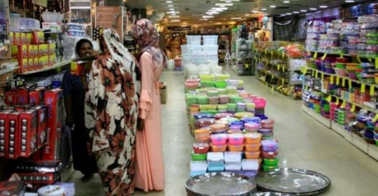 Sudanese business owners fear that months of political turmoil could bring on a full-scale economic collapse.  By Ebrahim HAMID (AFP)