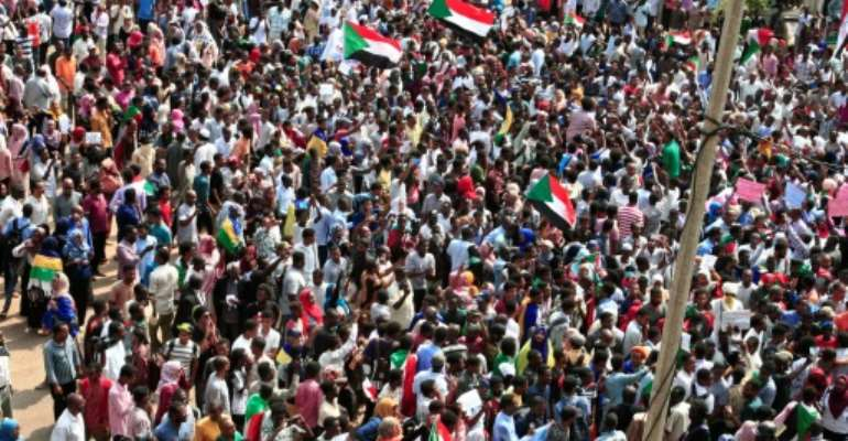 Sudanese citizens protested outside the presidential palace in Khartoum Thursday, in a bid to keep up the pressure on a transitional authority to ensure those responsible for killing demonstrators earlier this year are held to account.  By Ebrahim HAMID (AFP)