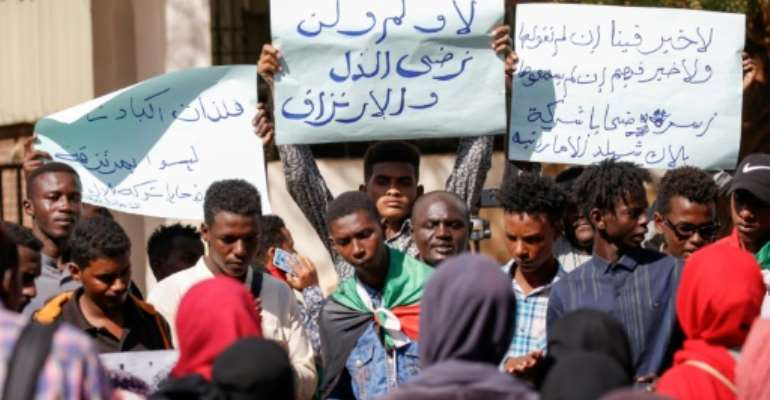 Sudanese citizens protested Tuesday against their relatives allegedly being sent to conflict zones after a UAE based firm hired them as security guards.  By ASHRAF SHAZLY (AFP)