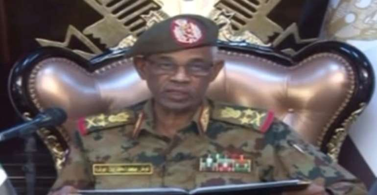 Sudanese Defence Minister Ahmed Awad Ibnouf announces the army has removed president Omar al-Bashir from power.  By - (Sudan TV/AFP)