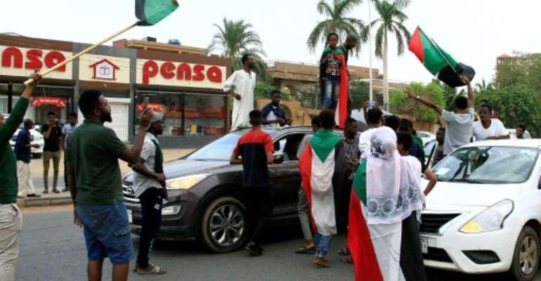 Sudanese demonstrators celebrate in Khartoum on August 3, 2019.  By Ebrahim HAMID (AFP/File)